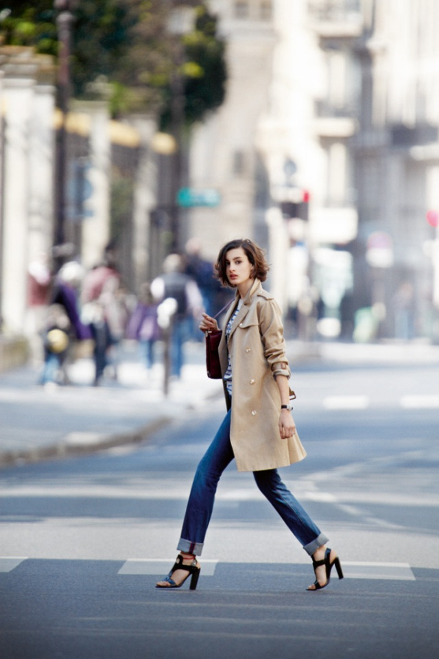 Girl crossing the street in a trench coat